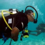 Maldivian President Mohammed Nasheed arrives for an underwater meeting of the Maldives' Cabinet (AP Photo/Mohammed Seeneen).