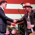 Republican presidential candidate, Mitt Romney shakes hands with musician Kid Rock at a campaign rally. (AP Photo/Gerald Herbert)