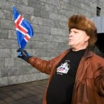 A protestor waves an Icelandic flag outside the Central Bank of Iceland during a demonstration in Reykjavik, Oct. 10, 2008 (AP Photo/Arni Torfason).